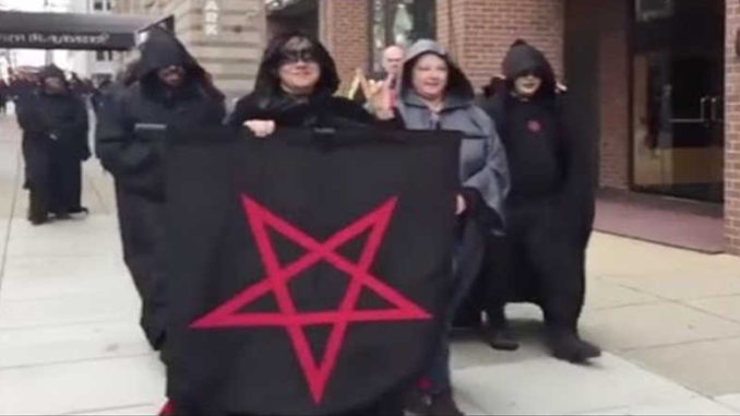 Satanists march against Trump.